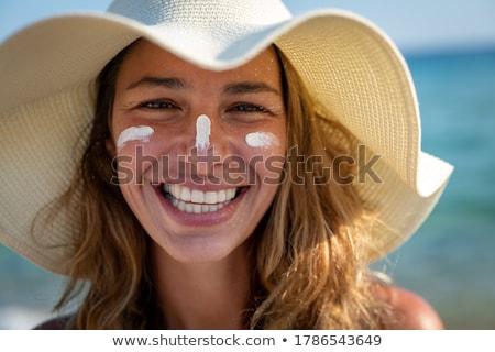 Toned Body of Woman Sunbathing at the Beach Stock photo © dash