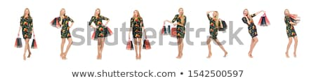 Tall model in mini green dress isolated on white Stock photo © Elnur