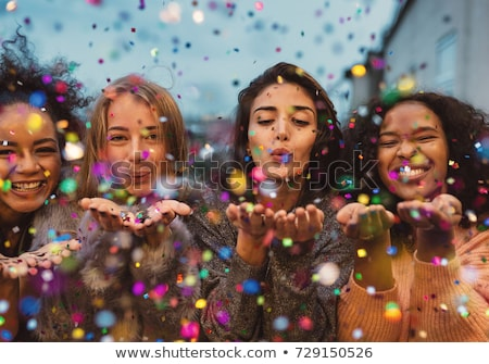 Young woman blowing Christmas confetti Stock photo © dash