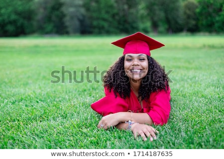 Woman in red graduation gown Stock photo © bluering