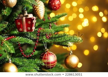 Green Christmas tree with balls and garlands Stock photo © orensila