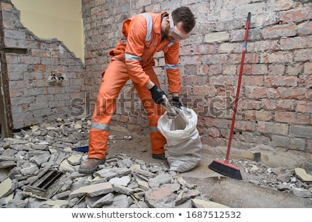 Cleaner cleaning up garbage on the floor Stock photo © bluering