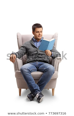 Vertical image of man sitting on armchair Stock photo © deandrobot