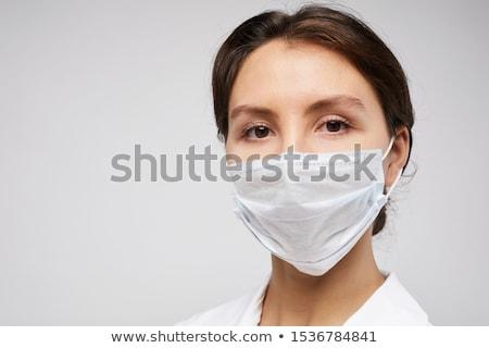 Feminino médico enfermeira máscara cirúrgica Foto stock © deandrobot