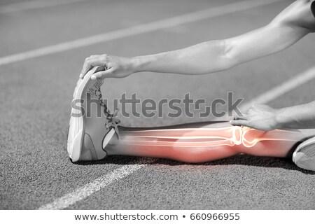 Low section of sportswoman stretching on sports track Stock photo © wavebreak_media