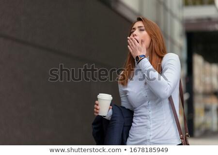 удивительный молодые кавказский женщину ходьбе улице Сток-фото © deandrobot
