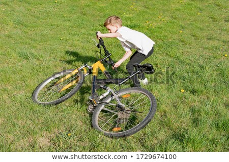Teen boys lifting bikes in air Stock photo © IS2