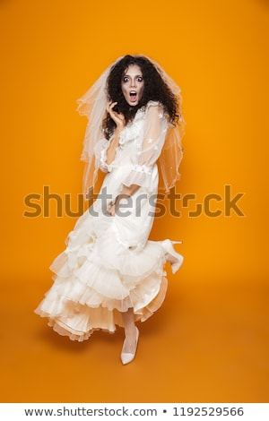 Full length image of young frightening zombie woman in dress Stock photo © deandrobot