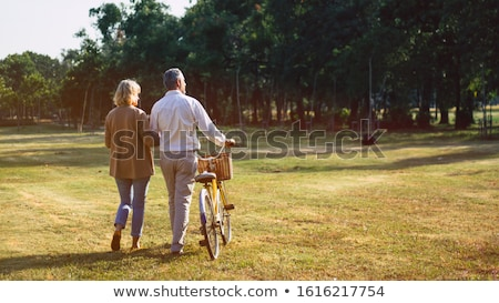 portrait of couple walking in garden stock photo © is2