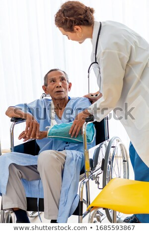 Male doctor checks a patients hand Stock photo © IS2