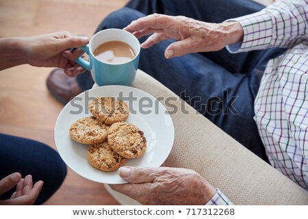 man offering biscuits to senior woman Stock photo © IS2