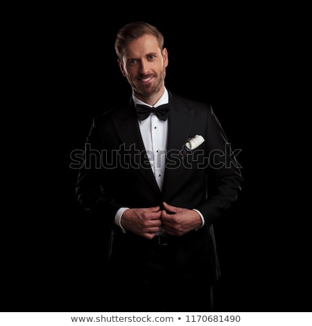 elegant man unbuttoning his tuxedo and laughs Stock photo © feedough