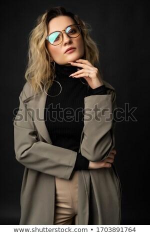 élégante jeunes dame posant sombre jeune femme Photo stock © majdansky