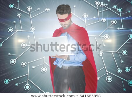 Businessman pretending to be a super hero using laptop Stock photo © wavebreak_media