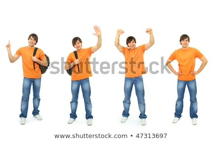 Teenage boy standing with hand up smiling Stock photo © monkey_business