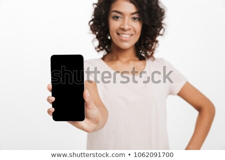 Brunette woman with afro hair doing commercial and demonstrating Stock photo © deandrobot