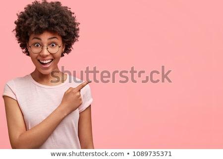 portret · zachwycony · kobieta · ciemne · kręcone · włosy - zdjęcia stock © deandrobot