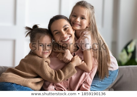Stock photo: Childhood, love, happiness and family bonds. Indoor portrait of beautiful cute children sisters and