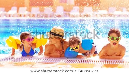 little girl having fun in the water park stock photo © galitskaya