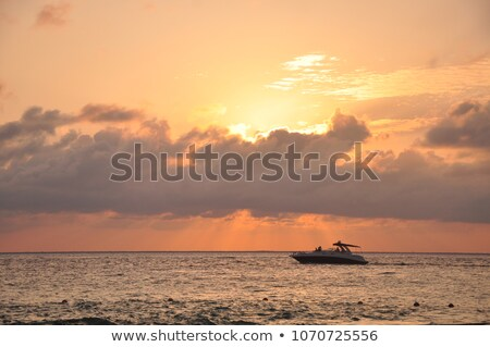 Caribbean sea sunset in Mexico Isla Mujeres boat Stock photo © lunamarina