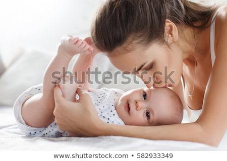 красивой · матери · ребенка · кровать · мамы - Сток-фото © lopolo