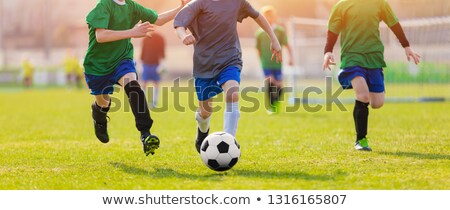 running soccer football players during the sunrise footballers stock photo © matimix