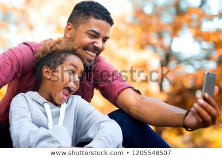 vader · zoon · park · voorjaar · man - stockfoto © dolgachov