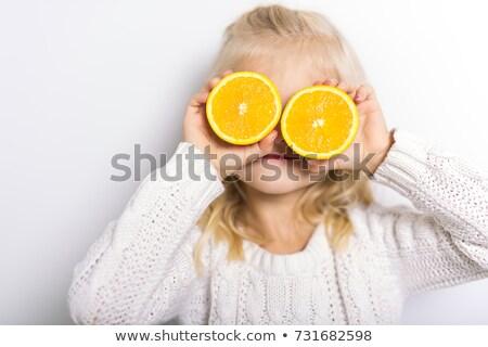 Cute girl 4-5 year old posing in studio with fruit orange Stock photo © Lopolo