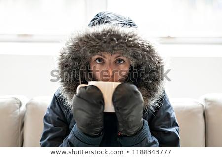 Mujer bebida fría café sofá casa invierno Foto stock © Lopolo