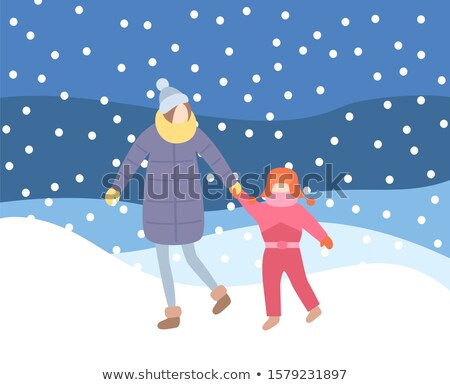 Mother Kid Walking in Evening Blizzard Wintertime Stock photo © robuart