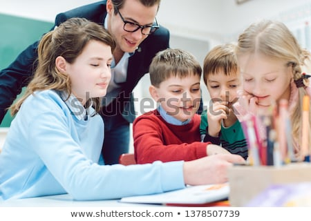 Team session in school class with all students working together Stock photo © Kzenon