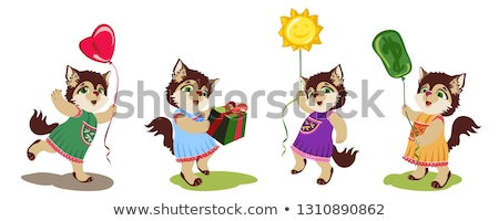Little cat with the ballons and box stock photo © heliburcka
