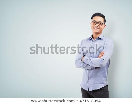 boldog · fiatalember · mobiltelefon · konyha · kockás · póló - stock fotó © deandrobot