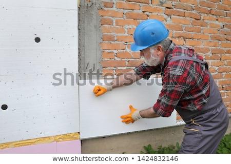 Ev duvar yalıtım kadın işçi Stok fotoğraf © simazoran