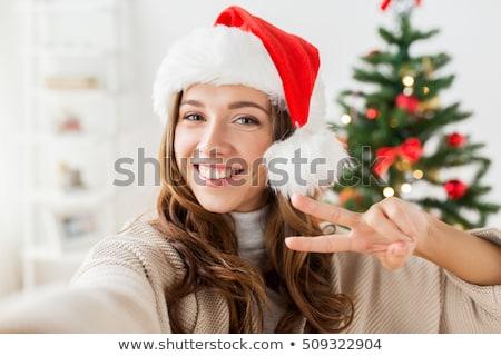 gelukkig · vrouw · winter · bont · hoed · smartphone - stockfoto © dolgachov