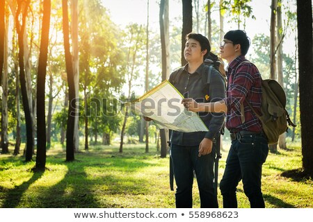 two young man traveler with backpack handle map relaxing outdoor stock photo © freedomz