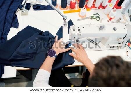 Eller genç dikiş makinesi çalışma bir Stok fotoğraf © pressmaster