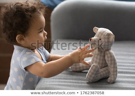 happy children playing with soft toys at home Stock photo © dolgachov