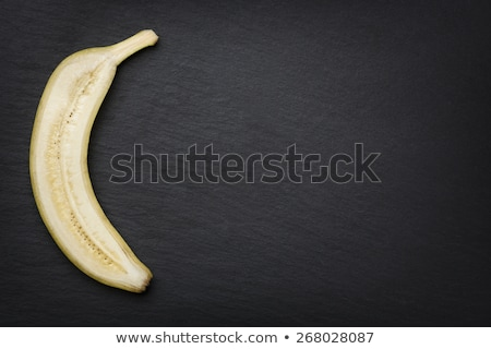 Half banana cut through on slate. Stock photo © lichtmeister