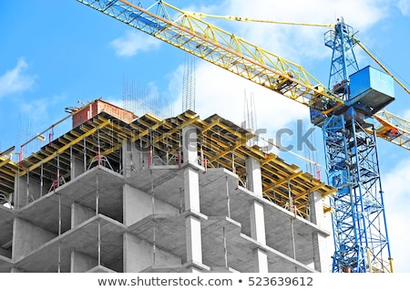 city with skyscrapers and new building with cranes stock photo © robuart