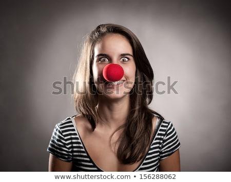 Gülen kırmızı genç kız palyaço burun gün Stok fotoğraf © dolgachov