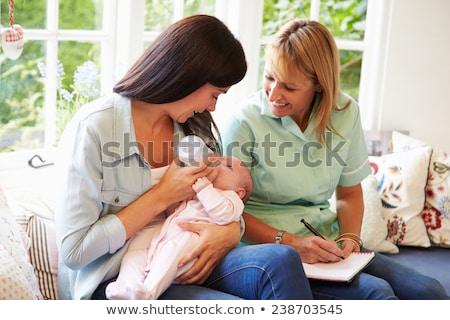 Gesundheit Besucher Baby Ernährung Flasche Frau Stock foto © HighwayStarz