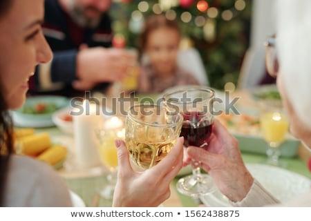 Kezek fiatal nő nagyi szemüveg bor vacsora Stock fotó © pressmaster