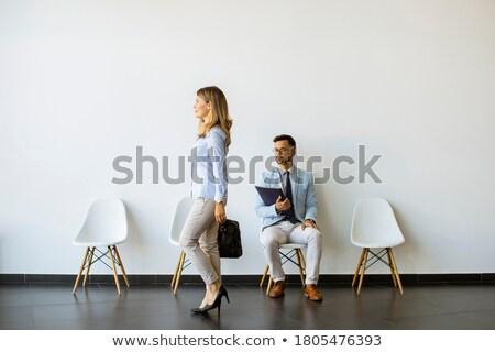 молодым человеком сидят зал ожидания папке стороны Председатель Сток-фото © boggy