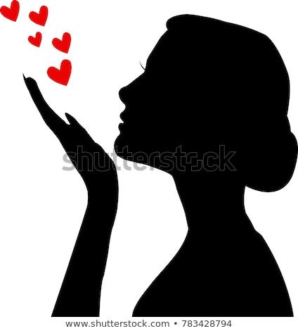 Stock photo: Silhouette woman blowing heart