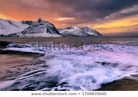 view of a sunset from the rocky coast long exposure shot stock photo © moses