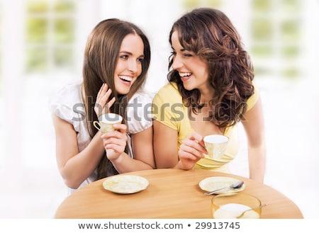 dos · sonriendo · mujeres · sesión · potable · café - foto stock © hasloo