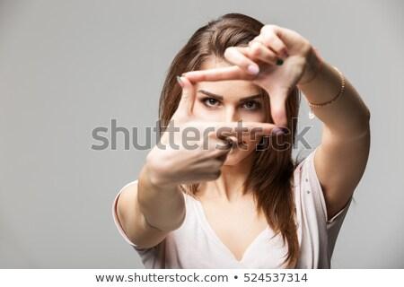 привлекательный · фоторамка · пальцы · портрет - Сток-фото © williv