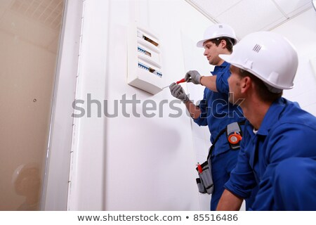 Tradesmen installing a distribution board Stock photo © photography33