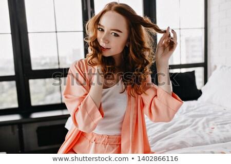 szczęśliwy · kobieta · piżama · gry · włosy · biały - zdjęcia stock © Rob_Stark